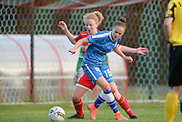 20160513 - LIEGE , BELGIUM : duel pictured between Gent's Amber Maximus (right) and Standard's Charlotte Tison (left) during a soccer match between the women teams of  Standard Femina De Liege and KAA Gent Ladies , during the fifth matchday in the SUPERLEAGUE Playoff 1 , Friday 13 May 2016 . PHOTO SPORTPIX.BE / DAVID CATRY