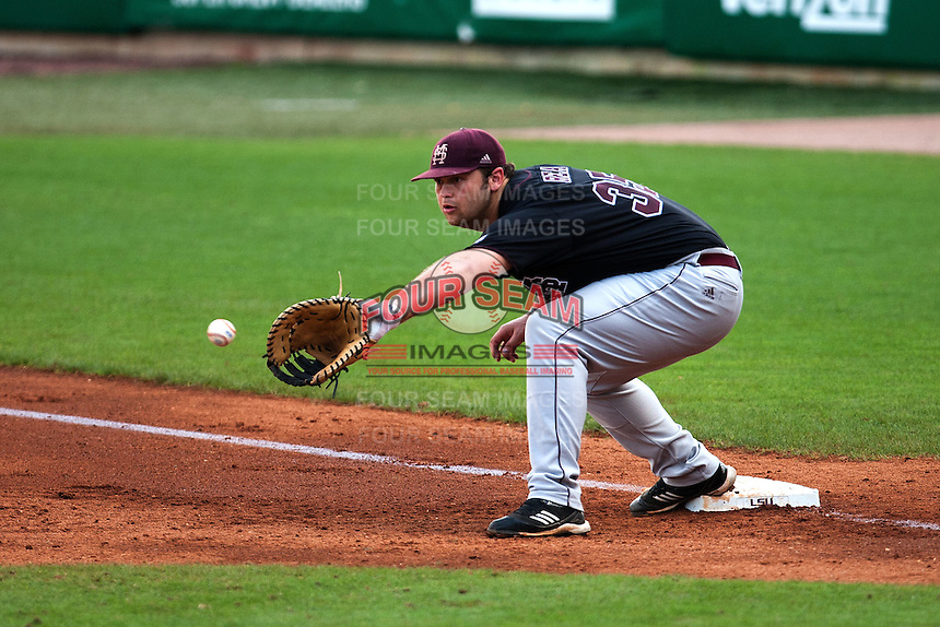 Mississippi State Bulldog first baseman Wes Rea #35 records a putout during the NCAA baseball game against the LSU Tigers on March 18, 2012 at Alex Box Stadium in Baton Rouge, Louisiana. LSU defeated Mississippi State 4-2. (Andrew Woolley / Four Seam Images).