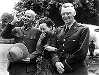 Generalissimo and Madame Chiang Kai Shek and Lt. Gen. Joseph W. Stilwell, Commanding General, China Exped. Forces, on the day following Japanese bombing attack (Doolittle Raid).  Maymyo, Burma.  April 19, 1942.  Capt. Fred L. Eldridge.  (Army)<br /> NARA FILE #:  111-SC-134627<br /> WAR & CONFLICT BOOK #:  747
