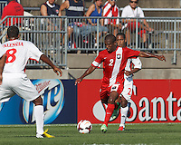 Belize midfielder David Trapp (2) passes the ball.  In CONCACAF Gold Cup Group Stage, the national team of Cuba (white) defeated national team of Belize (red), 4-0, at Rentschler Field, East Hartford, CT on July 16, 2013.