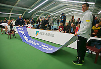 18-01-14,Netherlands, Rotterdam,  TC Victoria, Wildcard Tournament, ,   Glenn Smits (NED)  supporters folding up their baner<br /> Photo: Henk Koster