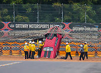 Sep 21, 2018; Madison, IL, USA; NHRA safety safari rescue crews tend to pro mod driver Mike Bowman after his parachutes failed to deploy and he crashed through the sand trap into the emergency catch net containment system during qualifying for the Midwest Nationals at Gateway Motorsports Park. Bowman was uninjured in the crash. Mandatory Credit: Mark J. Rebilas-USA TODAY Sports