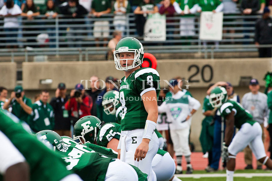 Eastern Michigan quarterback Alex Gillett (8) looks towards his sideline for a playcall in the first quarter of an NCAA college football game with Central Michigan, Saturday, Sept. 18, 2010, in Ypsilanti, Mich. (AP Photo/Tony Ding)