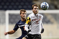 Maryland Terrapins forward Patrick Mullins (15) plays the ball in front of Virginia Cavaliers defender Zach Carroll (2). The Maryland Terrapins defeated Virginia Cavaliers 2-1 during the semifinals of the 2013 NCAA division 1 men's soccer College Cup at PPL Park in Chester, PA, on December 13, 2013.