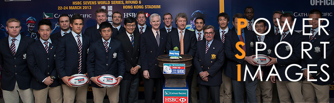 From L to R: Mr Grant Jamieson, Mr Pang Chung, Mr John Slosar, Mr Gordon French, Mr Brian Stevenson and Mr Rod Mason pose with members of the Hong Kong rugby squads during the Cathay Pacific/HSBC Hong Kong Sevens 2013 Official Draw held at Hysan Place, Hong Kong on 21st February 2013. Photo Raf Sanchez / The Power of Sport Images