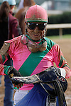 """Jockey Luis S. Quinonez  is all smiles along with muddy after a 2nd place finish with """"I AM MISS BROWN"""" in the 3rd race at Oaklawn Park 1-11-13  . (Justin Manning/Eclipse Sportswire)"""