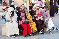 Meknes, Morocco.  Women Sitting, Talking in the Place Hedime.