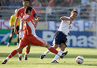 Jesse Marsch tries to get around a tackle. The USA defeated China, 4-1, in an international friendly at Spartan Stadium, San Jose, CA on June 2, 2007.