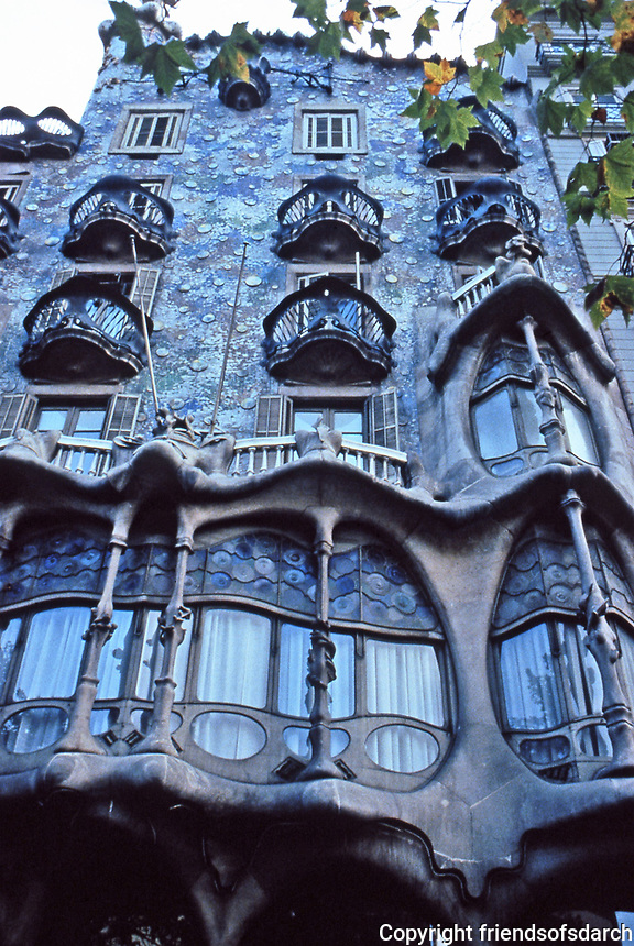 Casa Batlló, a building in the center of Barcelona designed by Antoni Gaudí.<br /> Note the tracery, irregular oval windows and flowing sculpted stone work.