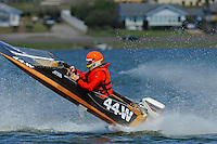 Frame 4: Bruce Hansen (44-W) blows over in a turn then turns upright after landing.....Stock  Outboard Winter Nationals, Ocoee, Florida, USA.13/14 March, 2010 © F.Peirce Williams 2010