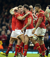 Jamie Roberts of Wales (C) celebrates his try with Dan Biggar and other team mates during the RBS 6 Nations Championship rugby game between Wales and Scotland at the Principality Stadium, Cardiff, Wales, UK Saturday 13 February 2016