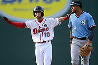 Center fielder Cole Brannen (10) of the Greenville Drive gestures to the dugout after hitting a double in a game against the Hickory Crawdads on Wednesday, May 15, 2019, at Fluor Field at the West End in Greenville, South Carolina. Greenville won, 6-5. (Tom Priddy/Four Seam Images)
