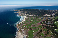 aerial photograph of of Pebble Beach, Monterey County, California; The Links at Spanish Bay and In at Spanish Bay in the foreground, Asilomar State Beach and Asilomar Hotel and Conference Grounds and Pacific Grove in the background