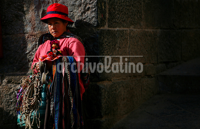 An Indian woman sells crafts on a street corner in Cusco, Peru, on May 14, 2008. Cusco is the historic capital of the Inca empire located in southeastern Peru, near the Urubamba Valley (Sacred Valley) of the Andes mountain range
