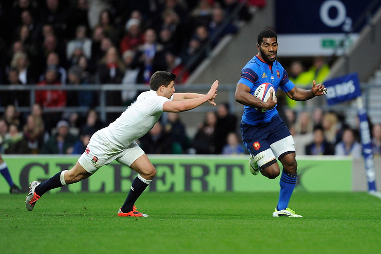 Noa Nakaitaci of France runs in a try as Ben Youngs of England attempts to push him off the pitch