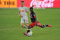 WASHINGTON, DC - SEPTEMBER 12: Mohammed Abu #25 of D.C. United battles for the ball with Mathias Jorgensen #25 of New York Red Bulls during a game between New York Red Bulls and D.C. United at Audi Field on September 12, 2020 in Washington, DC.