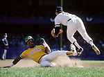 1981:  Rickey Henderson #31 of the Oakland Athletics slides to avoid the tag during a 1981 season game. (Photo by Rich Pilling)