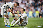Lucas Vazquez of Real Madrid talks to teammate Cristiano Ronaldo sitting on the pitch during the match Real Madrid vs RCD Espanyol, a La Liga match at the Santiago Bernabeu Stadium on 18 February 2017 in Madrid, Spain. Photo by Diego Gonzalez Souto / Power Sport Images