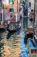 gondoliere provides tourists with an intimate tour of the city, Venice, Italy