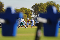 Sept. 16, 2009; Casa Grande, AZ, USA; Las Vegas Locomotives quarterback (3) Tim Rattay hands the ball off to running back (39) Josh Scobey during training camp at the Casa Grande Training Facility & Performance Institute. Mandatory Credit: Mark J. Rebilas-