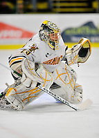 22 November 2011: University of Vermont Catamount goaltender Rob Madore, a Senior from Pittsburgh, PA, in action against the University of Massachusetts Minutemen at Gutterson Fieldhouse in Burlington, Vermont. The Catamounts defeated the Minutemen 2-1 in their annual pre-Thanksgiving meeting in the Hockey East season. Mandatory Credit: Ed Wolfstein Photo