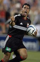 June 15, 2005; Washington, DC, USA; DC United's Christian Gomez (10) celebrates his goal against the Chicago Fire at RFK Stadium. DC United  won the game, 4-3.