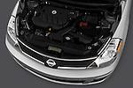 High angle engine detail of a  2009 Nissan Versa Hatchback.