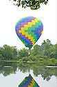 A single balloon, on approach for a splash n dash at the Pittsfield Balloon Festival.