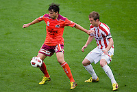 MELBOURNE, AUSTRALIA - NOVEMBER 14: Thomas Broich of the Roar defends the ball during the round 14 A-League match between the Melbourne Heart and Brisbane Roar at AAMI Park on November 14, 2010 in Melbourne, Australia (Photo by Sydney Low / Asterisk Images)