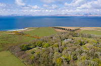 """BNPS.co.uk (01202) 558833. <br /> Pic: KnightFrank/BNPS<br /> <br /> Pictured: The castle has stunning views over Kilberry Bay and out to the islands of Islay, Jura and Gigha. <br /> <br /> A castle that was burnt down by a pirate, involved in the English Civil War and has been in the same family for five centuries is on the market for offers over £650,000.<br /> <br /> Kilberry Castle, which dates back to the 15th century, has an incredible history and still has a wealth of original features including a 288-year-old mausoleum.<br /> <br /> It sits in 21 acres of land on the Scottish west coast, with stunning views over Kilberry Bay and out to the islands of Islay, Jura and Gigha.<br /> <br /> The four-storey tower house now needs a buyer """"with deep pockets and great imagination"""" to carry out a complete refurbishment but it has a lot of potential."""