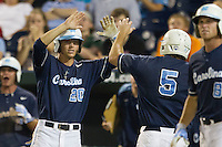 North Carolina outfielder Skye Bolt (20) greets teammate Michael Russell (5) after he scored during Game 10 of the 2013 Men's College World Series against the North Carolina State Wolfpack on June 20, 2013 at TD Ameritrade Park in Omaha, Nebraska. The Tar Heels defeated the Wolfpack 7-0, eliminating North Carolina State from the tournament. (Andrew Woolley/Four Seam Images)