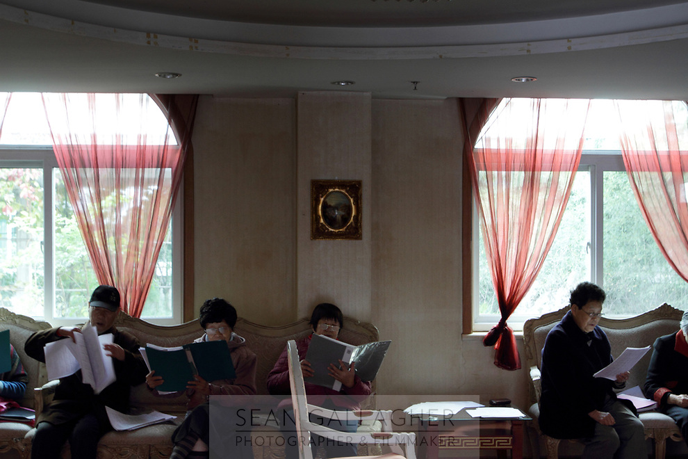 CHINA. Beijing. Residents during singing practice inside the Sun City retirement complex for the elderly. 2010