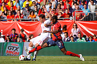 Maurice Edu (7) of the United States challenges Xabi Alonso (14)of Spain for the ball. The men's national team of Spain (ESP) defeated the United States (USA) 4-0 during a International friendly at Gillette Stadium in Foxborough, MA, on June 04, 2011.