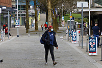 Pictured: A woman with a face mask walks through Oxford Street. Friday 19 March 2021<br /> Re: City centre of Swansea, Wales, UK.