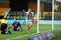 O's Danny Johnson scores for orient past Callum Burton and celebrtes during Cambridge United vs Leyton Orient, Sky Bet EFL League 2 Football at Abbey Stadium on 26th December 2020