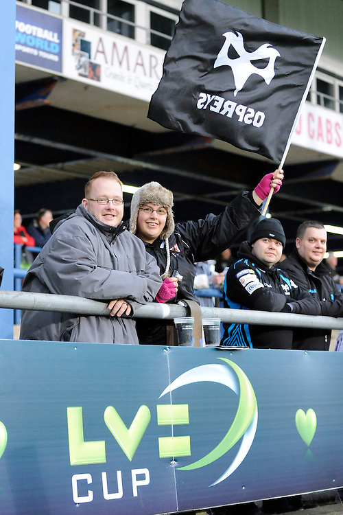 Ospreys fans cheer their team during the LV= Cup second round match between Ospreys and Northampton Saints at Riverside Hardware Brewery Field, Bridgend (Photo by Rob Munro)