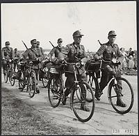 German soldiers on bicycles leave HET GOOI,HOLLAND,May 1945.