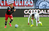 WASHINGTON, DC - MARCH 07: Eric Sorga #50 slips past Nicolás Figal #5 of Inter Miami during a game between Inter Miami CF and D.C. United at Audi Field on March 07, 2020 in Washington, DC.