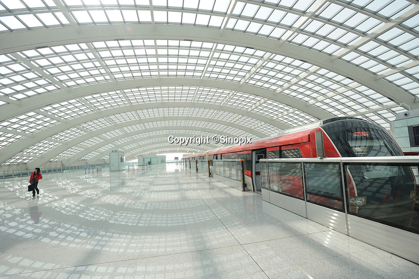 Airport Express Train Station at the Terminal 3 Beijing Capital International Airport. Designed by British architect Lord Norman Foster, the new terminal is the world's largest airport building.