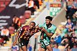 Bradford City 3, Carlisle United 1, 21/09/2019. Valley Parade, EFL League 2. The home team captain James Vaughan is challenged by ex-home team defender Nathaniel Knight-Percival during the first-half as Bradford City played Carlisle United in a Skybet League 2 fixture at Valley Parade. The home team were looking to bounce back after being relegated during a disastrous 2018-19 season on and off the pitch. Bradford won the match 3-1, watched by a crowd of 14, 217. Photo by Colin McPherson.