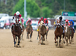 May 2, 2014: Rosie Napravnik celebrates atop of Untapable as they cross the line to win the 140th Kentucky Oaks at Churchill Downs in Louisville, KY. Logan Riely/ESW/CSM