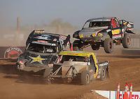 Apr 17, 2011; Surprise, AZ USA; LOORRS driver Rob Naughton (54) leads Brian Deegan (38) and Greg Adler (10) during round 4 at Speedworld Off Road Park. Mandatory Credit: Mark J. Rebilas-