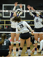 Fayetteville's Regan Haro (left) and Perry Flannigan (11) block a shot Tuesday, Sept. 15, 2020, by Allison Oliphant (28) Bentonville's during play in Tiger Arena in Bentonville. Visit nwaonline.com/200916Daily/ for today's photo gallery. <br /> (NWA Democrat-Gazette/Andy Shupe)
