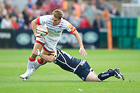 20120803 Copyright onEdition 2012©.Free for editorial use image, please credit: onEdition..Chris Wyles of Saracens is tackled by Tom Cruse of Sale Sharks at The Recreation Ground, Bath in the Final round of The J.P. Morgan Asset Management Premiership Rugby 7s Series...The J.P. Morgan Asset Management Premiership Rugby 7s Series kicked off again for the third season on Friday 13th July at The Stoop, Twickenham with Pool B being played at Edgeley Park, Stockport on Friday, 20th July, Pool C at Kingsholm Gloucester on Thursday, 26th July and the Final being played at The Recreation Ground, Bath on Friday 3rd August. The innovative tournament, which involves all 12 Premiership Rugby clubs, offers a fantastic platform for some of the country's finest young athletes to be exposed to the excitement, pressures and skills required to compete at an elite level...The 12 Premiership Rugby clubs are divided into three groups for the tournament, with the winner and runner up of each regional event going through to the Final. There are six games each evening, with each match consisting of two 7 minute halves with a 2 minute break at half time...For additional images please go to: http://www.w-w-i.com/jp_morgan_premiership_sevens/..For press contacts contact: Beth Begg at brandRapport on D: +44 (0)20 7932 5813 M: +44 (0)7900 88231 E: BBegg@brand-rapport.com..If you require a higher resolution image or you have any other onEdition photographic enquiries, please contact onEdition on 0845 900 2 900 or email info@onEdition.com.This image is copyright the onEdition 2012©..This image has been supplied by onEdition and must be credited onEdition. The author is asserting his full Moral rights in relation to the publication of this image. Rights for onward transmission of any image or file is not granted or implied. Changing or deleting Copyright information is illegal as specified in the Copyright, Design and Patents Act 1988. If you are in any way unsure of your right to publish this ima