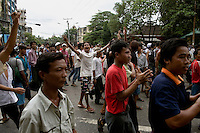 People line the streets during demonstrations calling for the overthrow of the country's military junta.