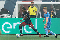 FOXBOROUGH, MA - SEPTEMBER 02: DeJuan Jones #24 of New England Revolution dribbles at midfield as Gary Mackay-Steven #17 of New York City FC closes during a game between New York City FC and New England Revolution at Gillette Stadium on September 02, 2020 in Foxborough, Massachusetts.