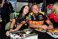 Oct. 27, 2011; Las Vegas, NV, USA: NHRA funny car drivers Alexis DeJoria (left) and Jeff Arend during the fanfest at Fremont Street. Mandatory Credit: Mark J. Rebilas-US PRESSWIRE