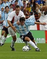 Dan Califf, left, Diego Milito, right, Argentina vs. USA, Miami, Fla.