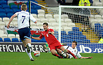 International Friendly match between Wales and Scotland at the new Cardiff City Stadium : Wales Ched Evans is tackled by Scotlands Gary Caldwell.