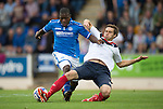 St Johnstone v FC Minsk...08.08.13 Europa League Qualifier<br /> Aliaksdandr Sviarchynski puts in a last ditch tackle on Nigel Hasselbaink<br /> Picture by Graeme Hart.<br /> Copyright Perthshire Picture Agency<br /> Tel: 01738 623350  Mobile: 07990 594431